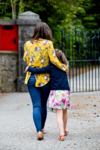 mother daughter walking hug