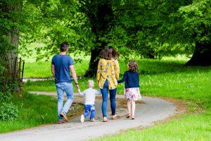 family walking down a lane