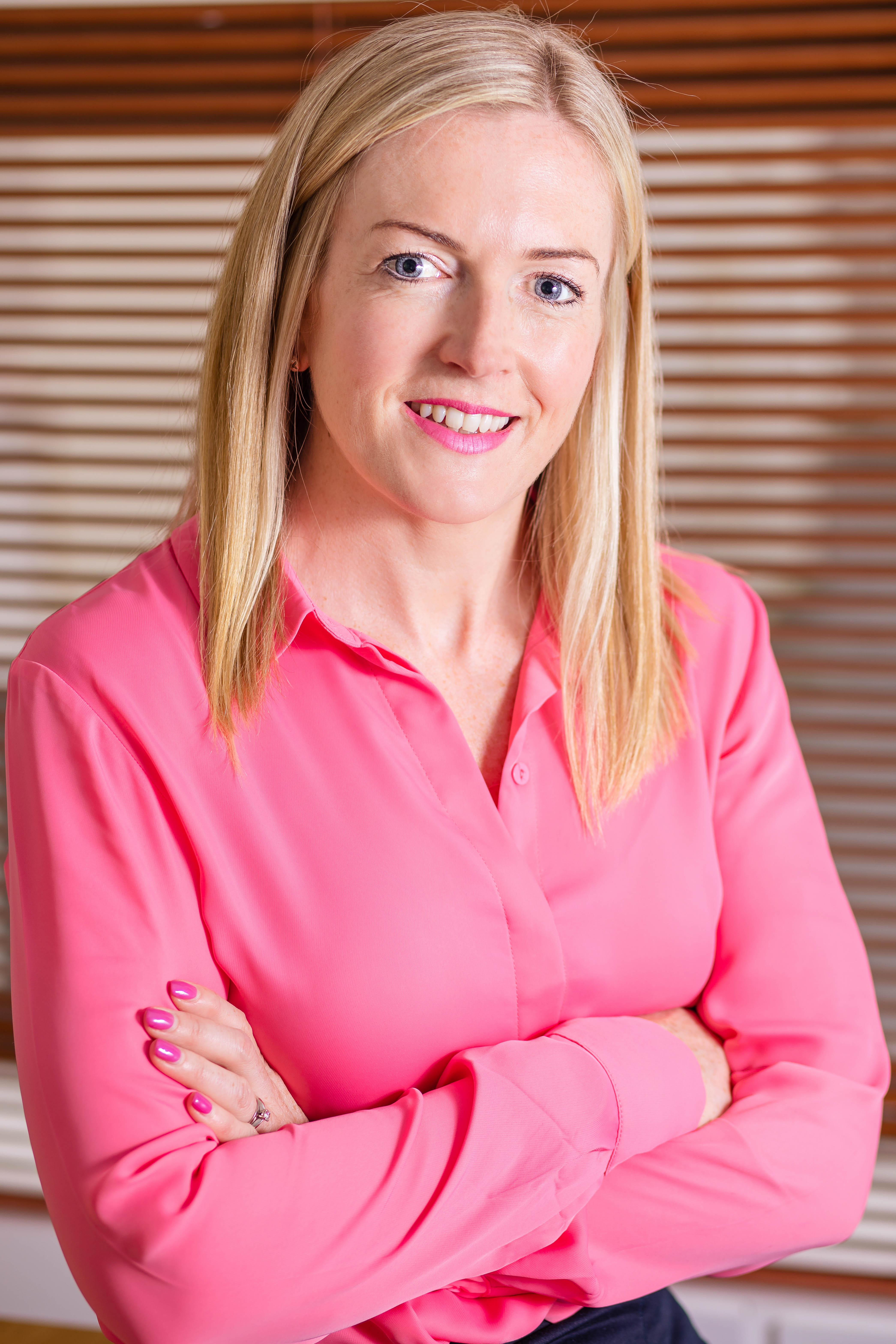 Female corporate headshot - businesswoman in pink shirt