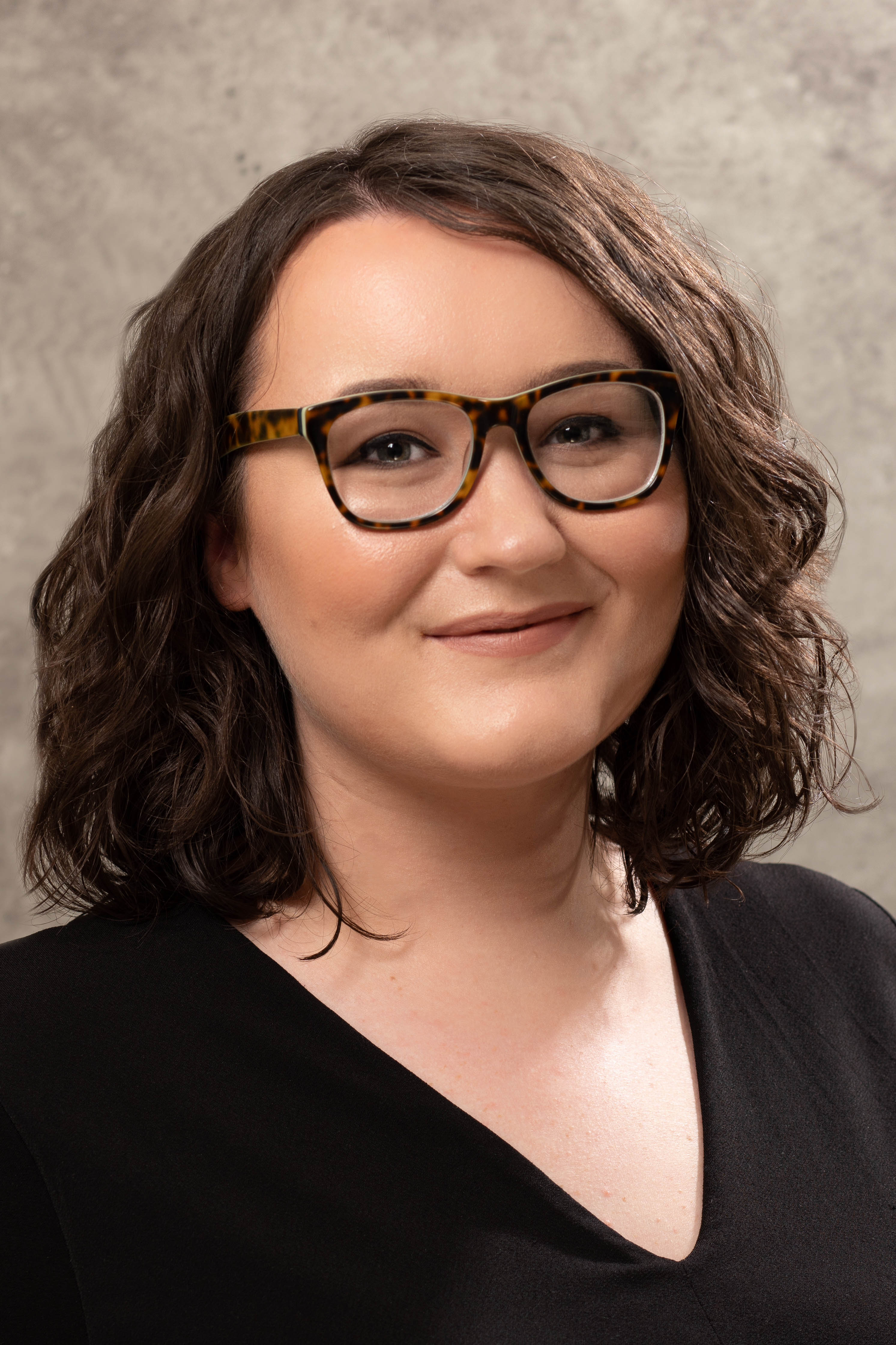 Female with glasses - corporate headshot