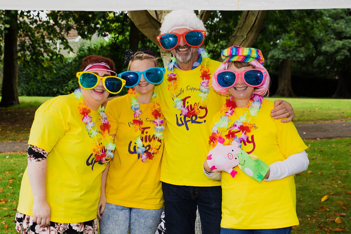 charity volunteers in fancy dress at an event