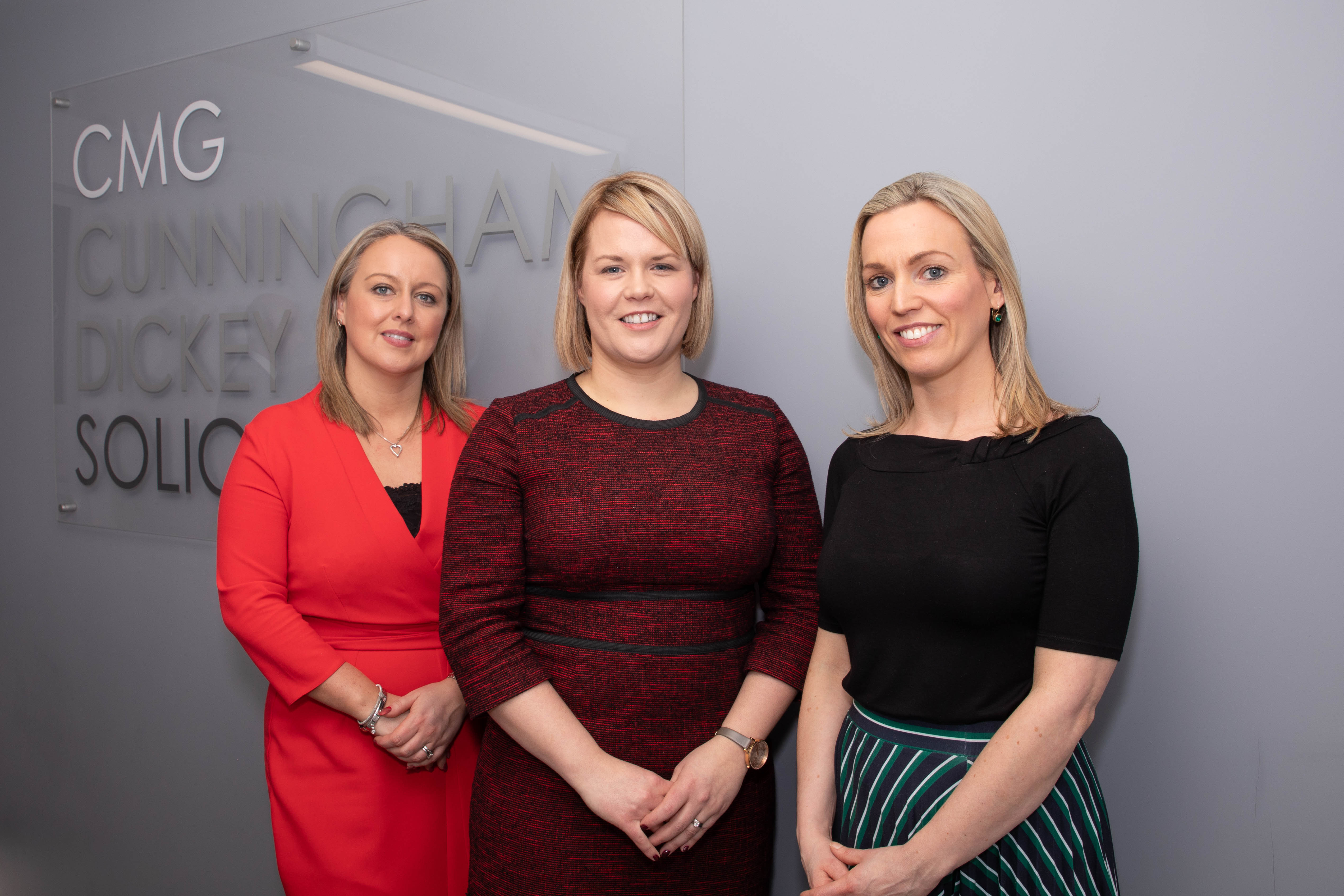 corporate office launch event - three professional women