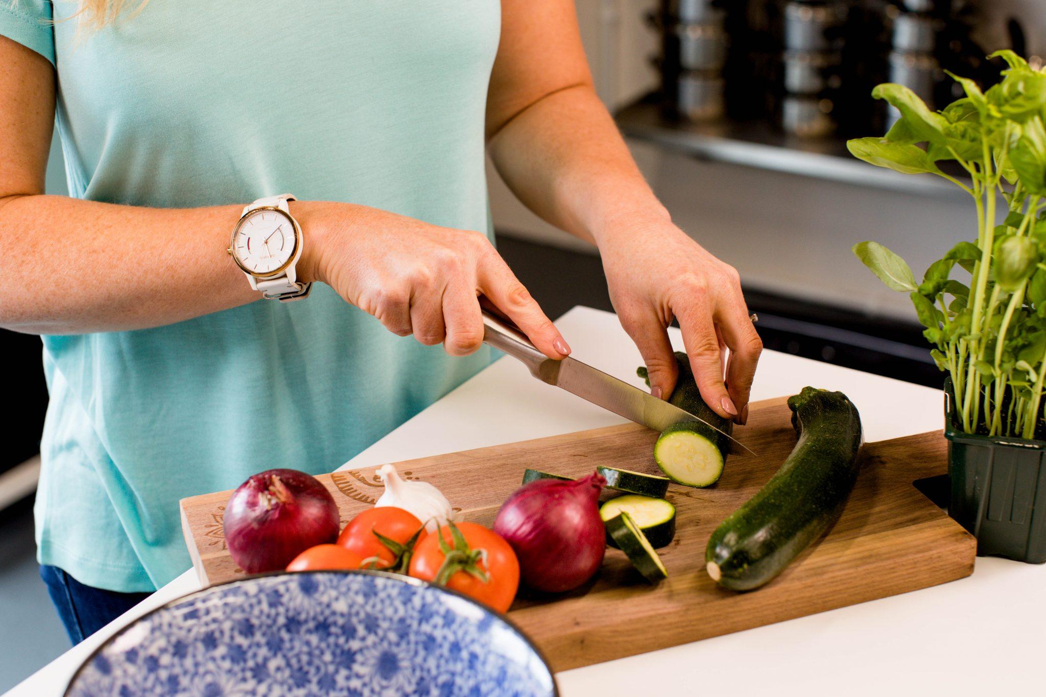 female hands chopping veg