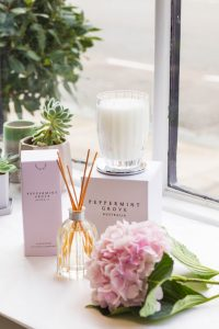 lifestyle product photo of candle, flowers and giftware