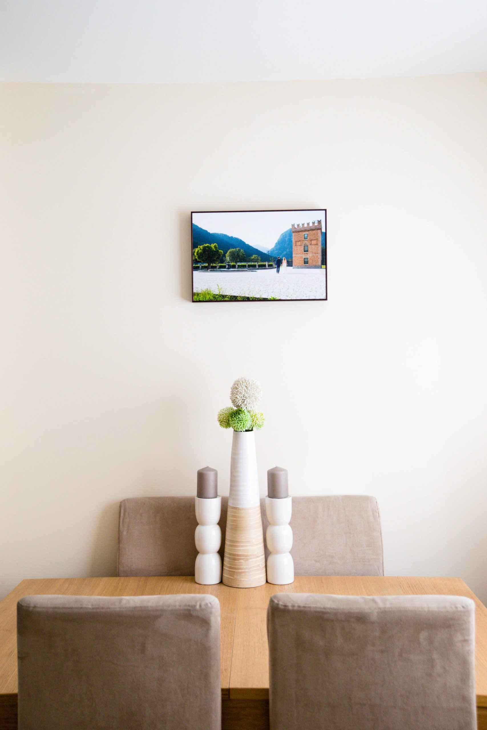 wall art above a table in a home
