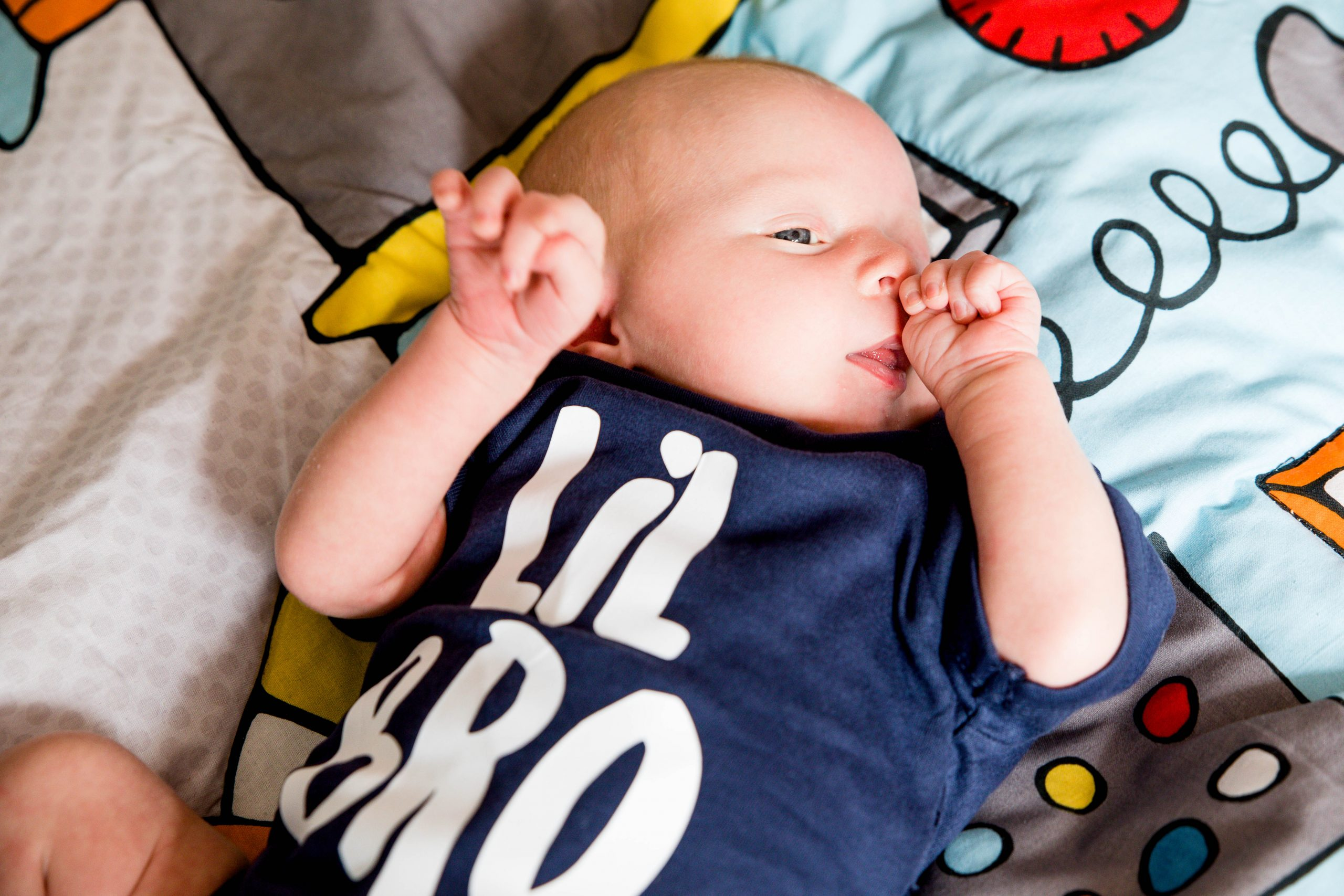 newborn baby with lil bro babygro