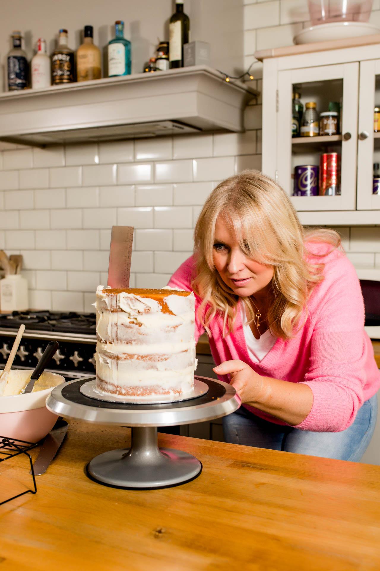female entrepreneur baker decorating a cake