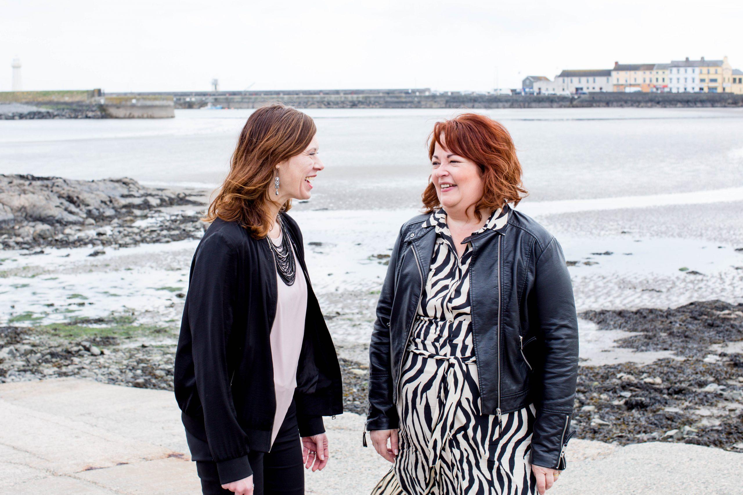 two female entrepreneurs chatting outdoors