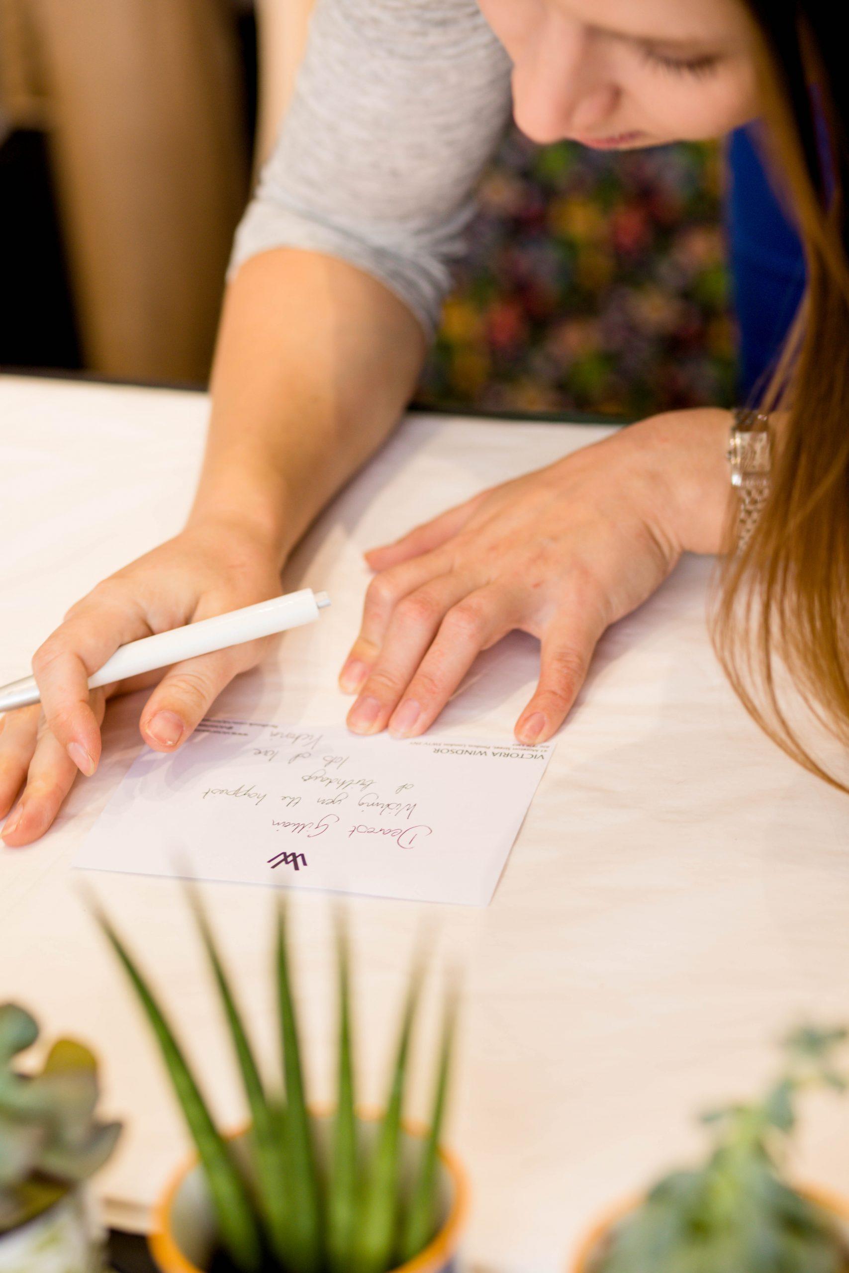 gift retailer writing personalised card