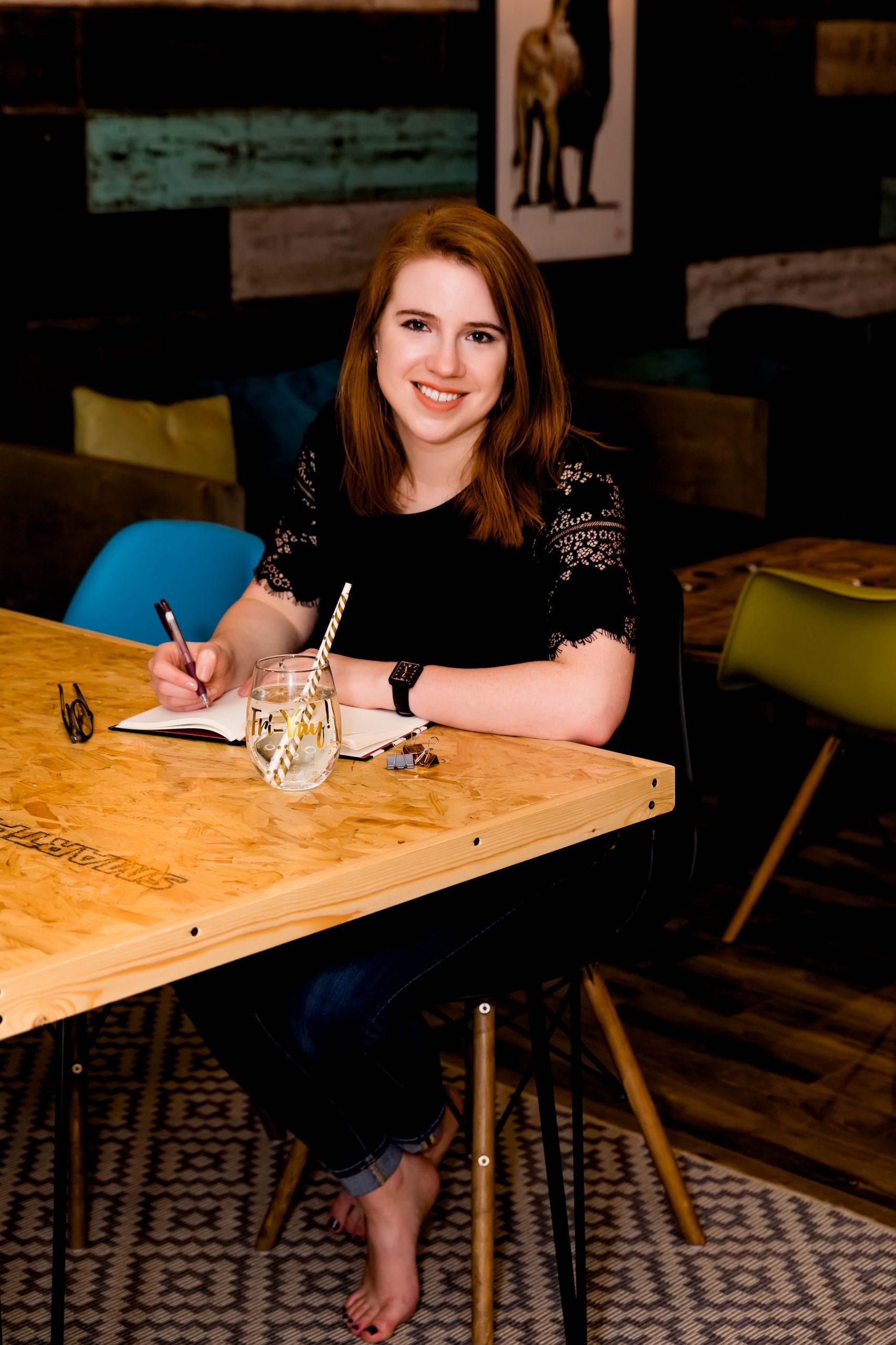 branding photograph female entrepreneur at desk