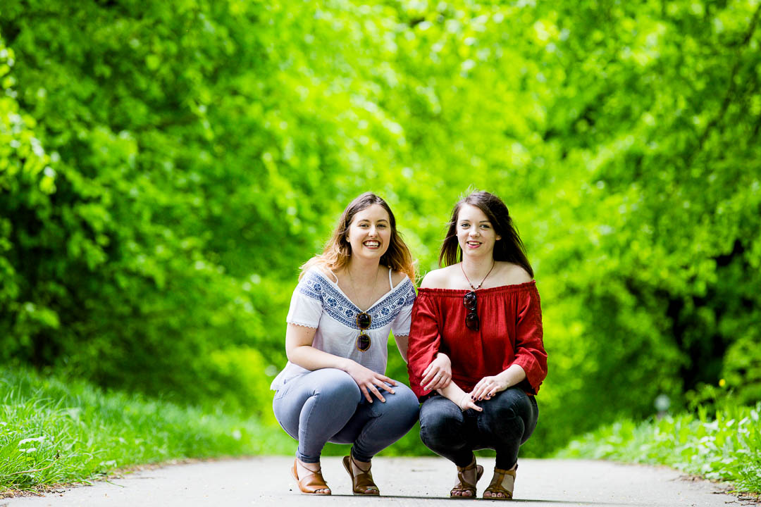 young adult portrait 2 girls outdoors in greenery