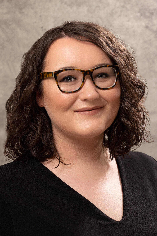 corporate headshot - female with glasses