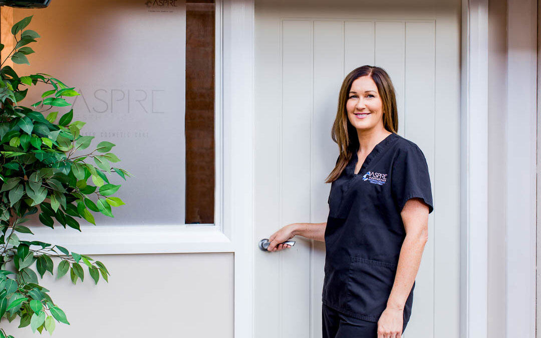 business portrait of aesthetics practitioner at treatment clinic door