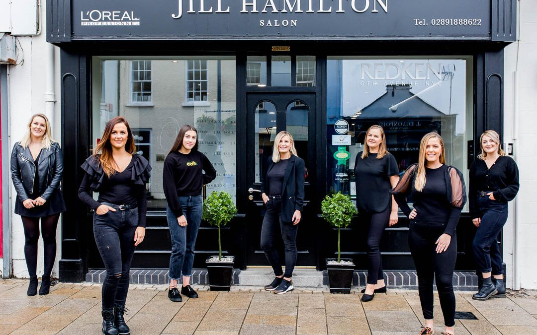 business portrait of salon team of hairdressers at salon doorstep