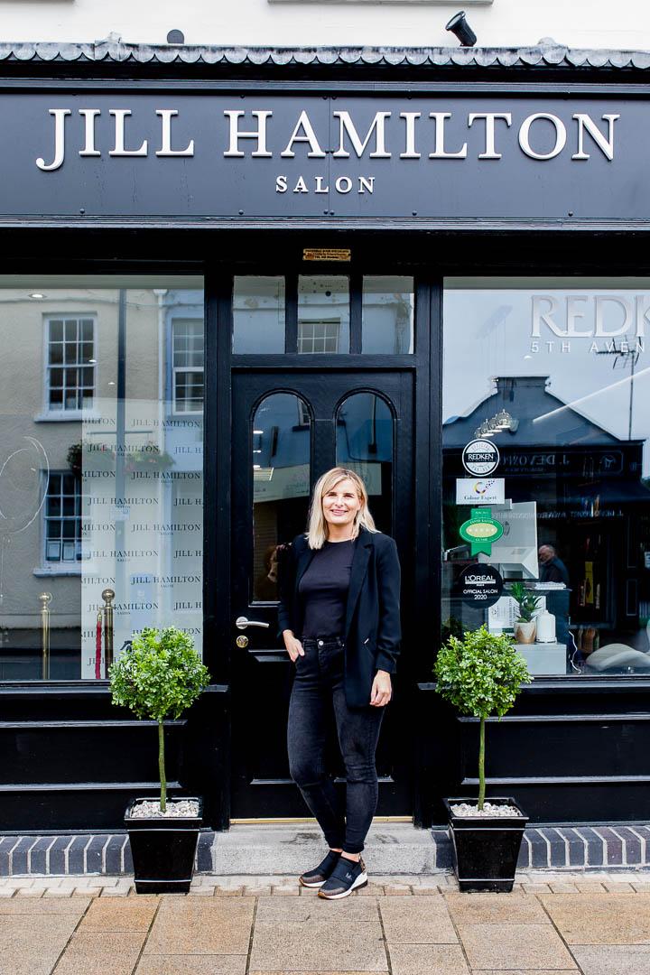 business portrait of salon owner at doorstep
