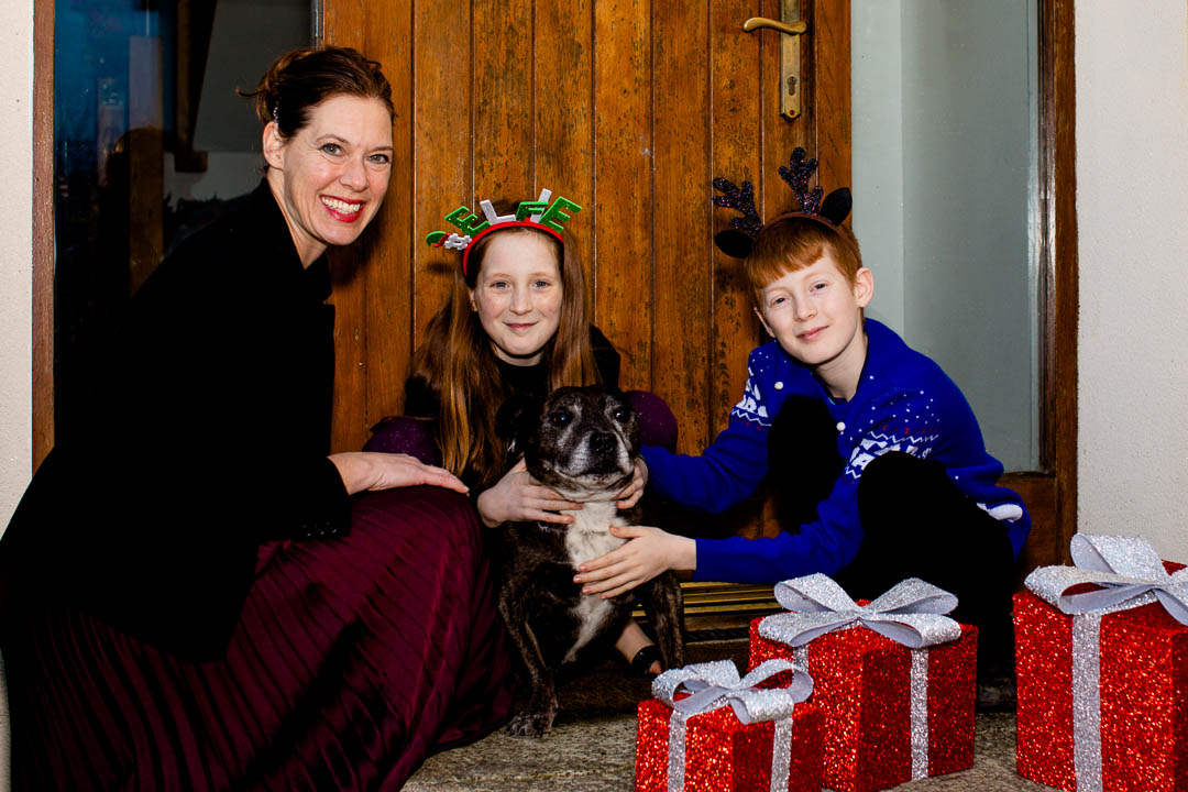 Doorstep Christmas portrait of family with dog