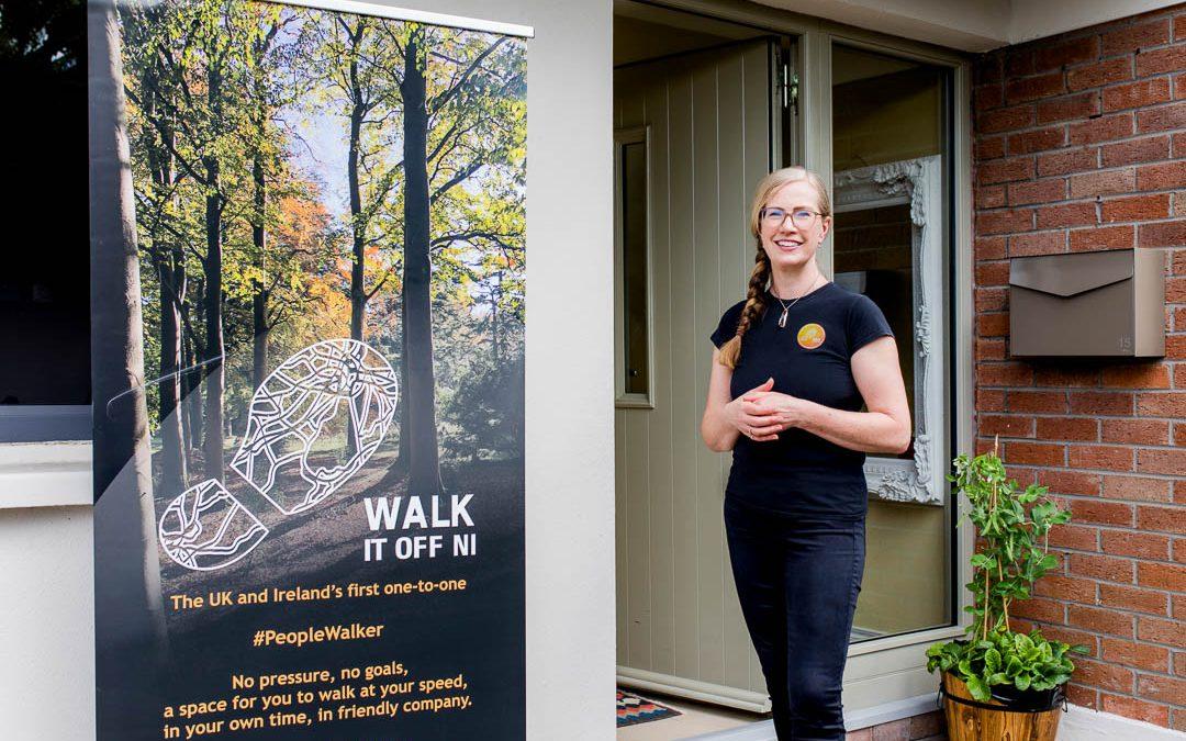 walking business owner doorstep portrait