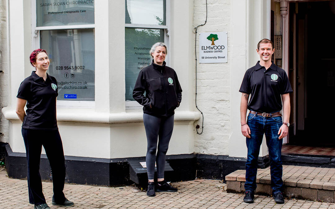 business doorstep portrait of chiropractic clinic team