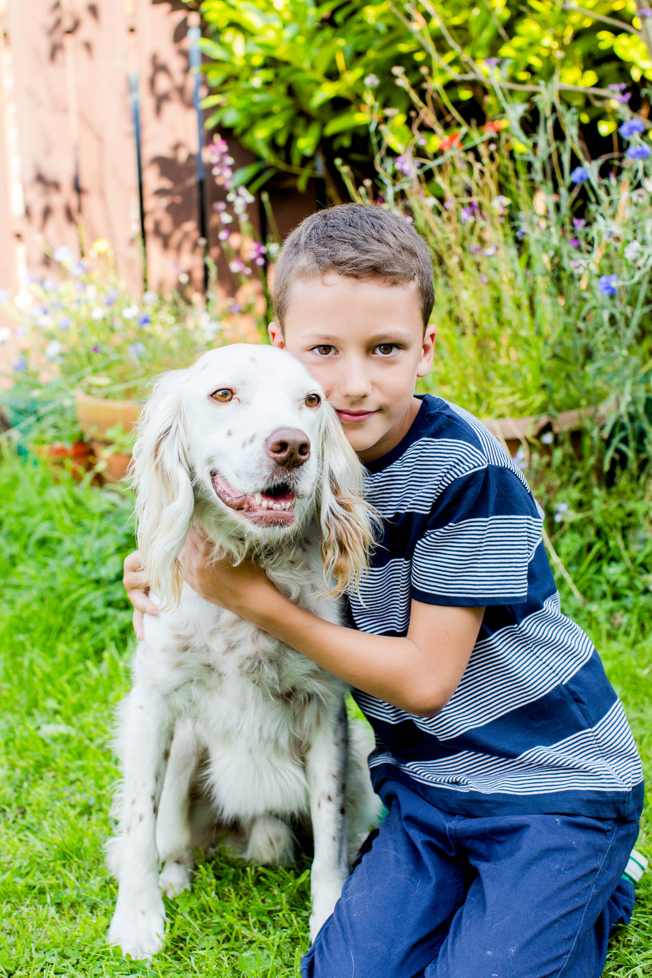 portrait of boy with family dog